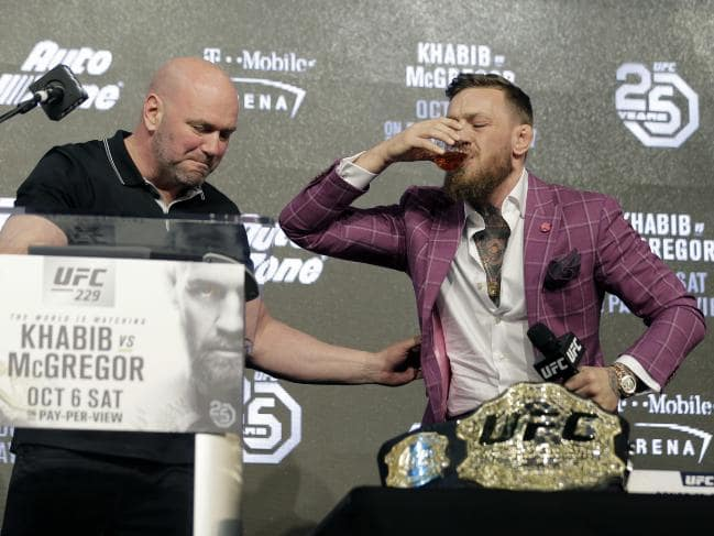 "Conor McGregor drinking his whiskey ""Proper 12"" at press conference"