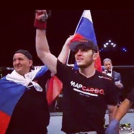 Khabib's father with the Russian flag after Makhachev's fight at UFC 208