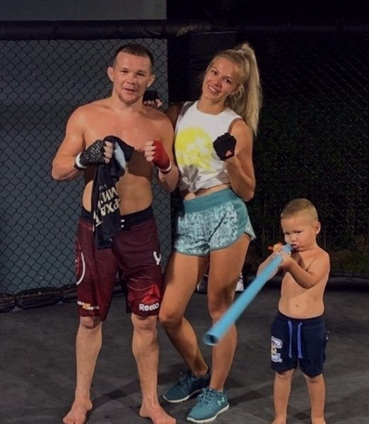 Petr Yan with his wife Yulia and oldest son Daniil